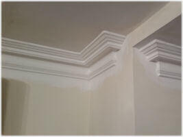 Coving that has been cut and shaped into and out of a tricky corner.