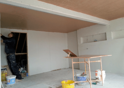 Newly plastered ceiling over plasterboard installed earlier that same day.