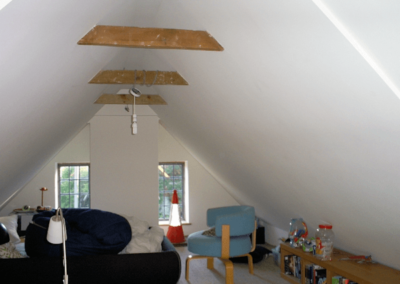 (Painted) Plaster in an loft conversion - Note the straight and smooth plastering despite the non-standard angles. Beams left exposed at the clients request.
